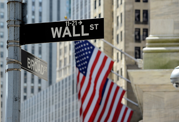 Wall Street sign in Manhattan, signifying U.S. stocks